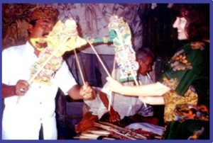 Penelope in Indonesia with shadow puppets.